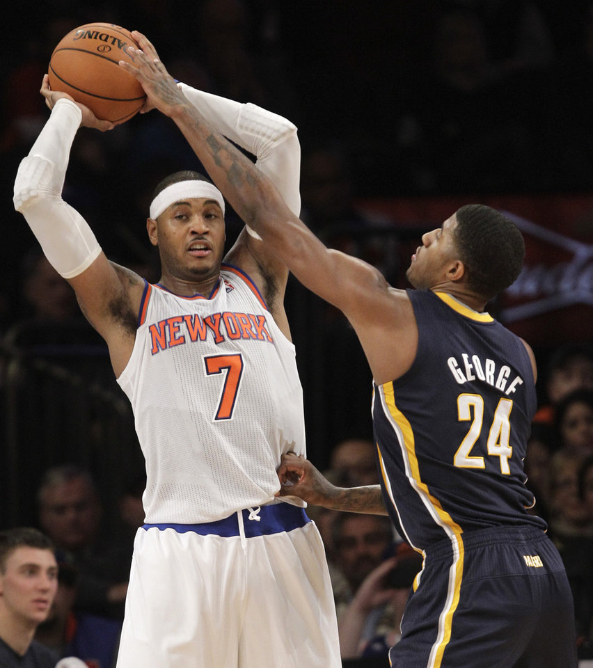 New York Knicks forward Carmelo Anthony (7) looks to pass as Indiana Pacers forward Paul George (24) defends in the first half of their NBA basketball game at Madison Square Garden in New York, Sunday, Nov. 18, 2012. (AP Photo/Kathy Willens)