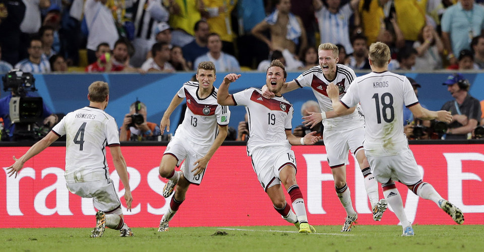 Photo - Germany's Mario Goetze (19) celebrates after scoring the opening goal during the World Cup final soccer match between Germany and Argentina at the Maracana Stadium in Rio de Janeiro, Brazil, Sunday, July 13, 2014.  (AP Photo/Matthias Schrader)