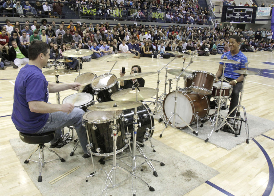 Principal Jason Pittenger has a drum contest against senior Seth Liggans as Edmond North High School holds its reporting assembly at the conclusion of BALTO week in Edmond, OK, Friday, Feb. 17, 2012. By Paul Hellstern, The Oklahoman