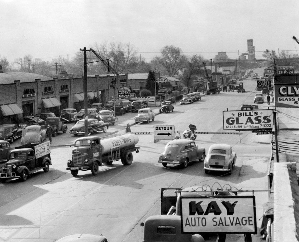 Photo -  The Akers family salvage and auto parts operation is shown in this 1940s era photo. [The Oklahoman Archives]