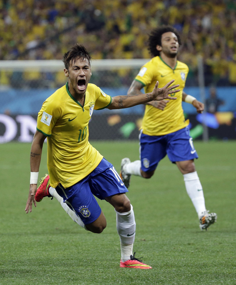 Photo - Brazil's Neymar celebrates after scoring his sides first goal during the group A World Cup soccer match between Brazil and Croatia, the opening game of the tournament, in the Itaquerao Stadium in Sao Paulo, Brazil, Thursday, June 12, 2014.  (AP Photo/Felipe Dana)