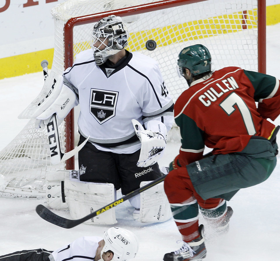 Minnesota Wild center Matt Cullen (7) watches as a shot by teammate Cal Clutterbuck makes it past Los Angeles Kings goalie Jonathan Bernier (45) during the first period of an NHL hockey game in St. Paul, Minn., Tuesday, April 23, 2013. (AP Photo/Ann Heisenfelt)