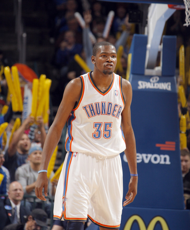 Photo - Oklahoma City Thunder's Kevin Durant (35) celebrates during the the NBA basketball game between the Oklahoma City Thunder and the San Antonio Spurs at the Chesapeake Energy Arena in Oklahoma City, Sunday, Jan. 8, 2012. Photo by Sarah Phipps, The Oklahoman