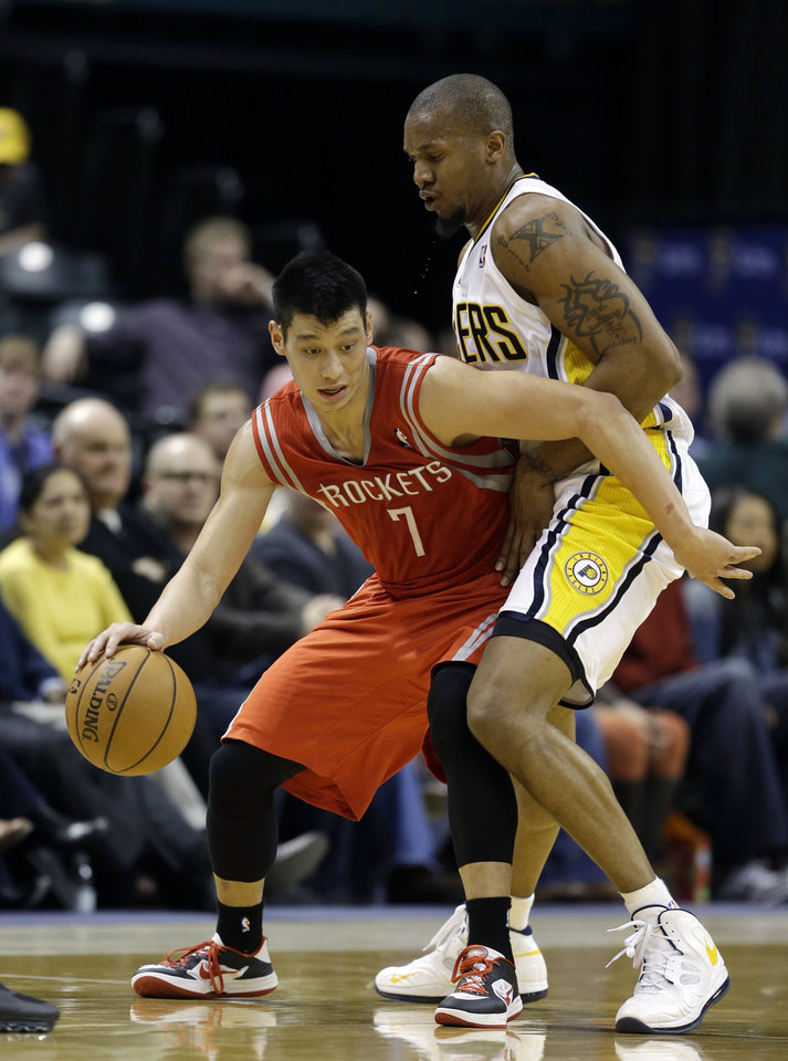 Photo - Houston Rockets' Jeremy Lin (7) is defended by Indiana Pacers' David West (21) during the second half of an NBA basketball game Friday, Jan. 18, 2013, in Indianapolis. The Pacers defeated the Rockets 104-93. (AP Photo/Darron Cummings)