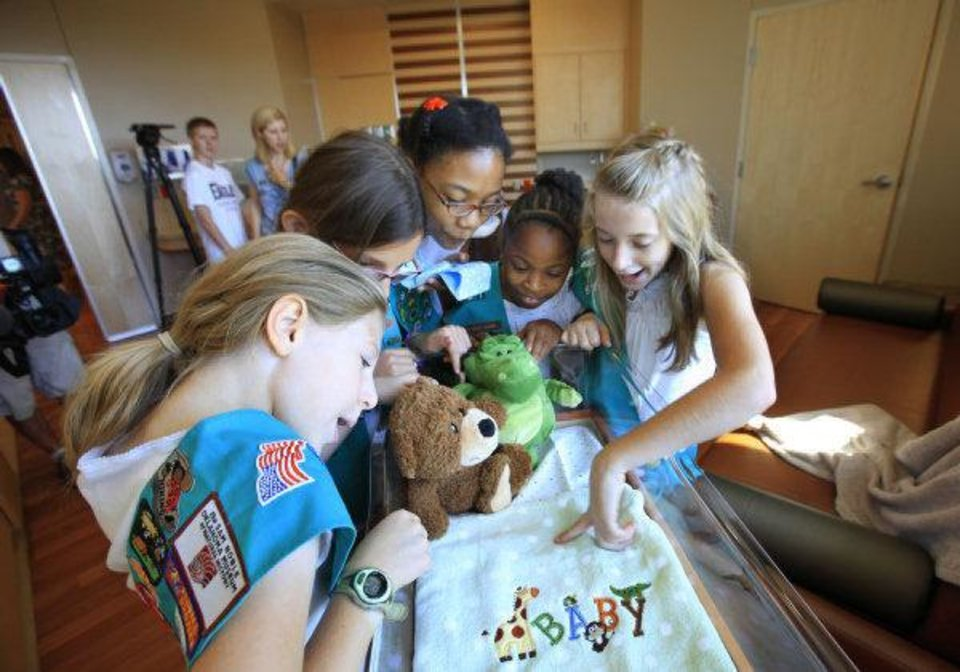 Photo - Junior Girl Scouts, from left, Jadyn Carter, Jemma Arbuckle, Sara McNeal, Jasmine Haulsey and Payton Merideth look over one of the labor and delivery rooms at the new Integris Health Edmond. PHOTO BY DAVID MCDANIEL, THE OKLAHOMAN  David McDaniel