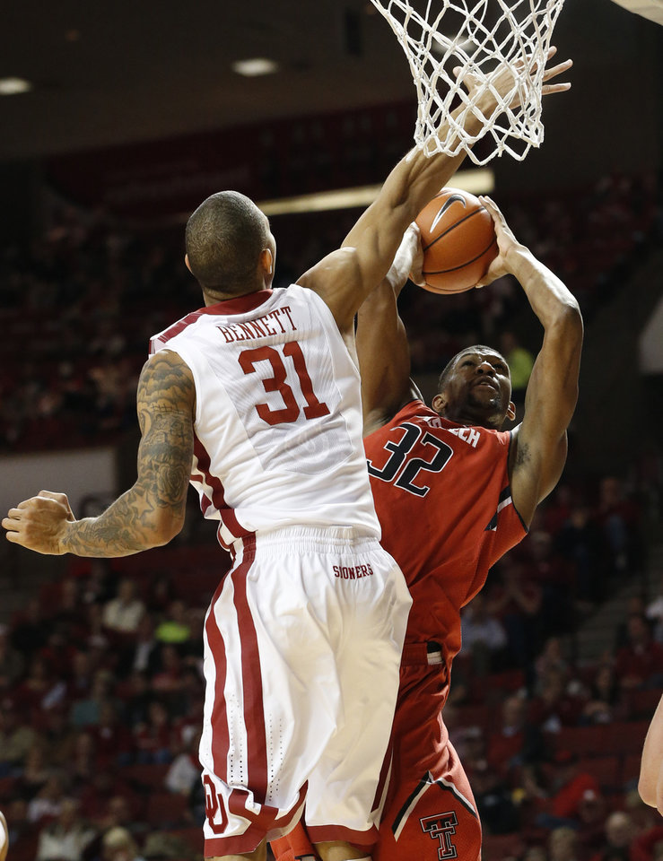 Photo - Texas Tech forward Jordan Tolbert (32) shoots as Oklahoma forward D.J. Bennett (31) defends during the first half on an NCAA college basketball game in Norman, Okla., Wednesday, Feb. 12, 2014. (AP Photo/Sue Ogrocki)