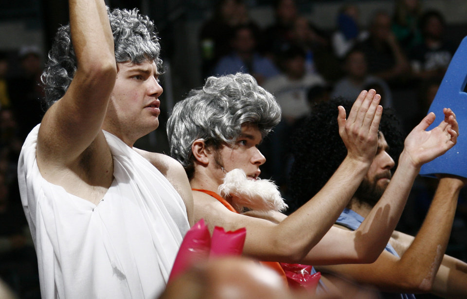 Thunder fans Wade Browning, left, and Ben Dilbeck cheer in the second half during the NBA basketball game between the Golden State Warriors and the Oklahoma City Thunder at the Ford Center in Oklahoma City, Monday, December 8, 2008. Golden State won, 112-102.  BY NATE BILLINGS, THE OKLAHOMAN