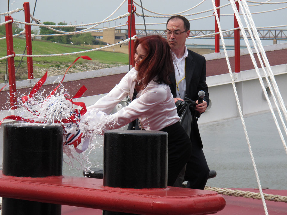 Priscilla Presley, the former wife of late rock and roll icon Elvis Presley, smashes a champagne bottle to christen the American Queen riverboat as it resumes travel on the Mississippi River on Friday, April 27, 2012 in Memphis, Tenn. (AP Photo/Adrian Sainz)