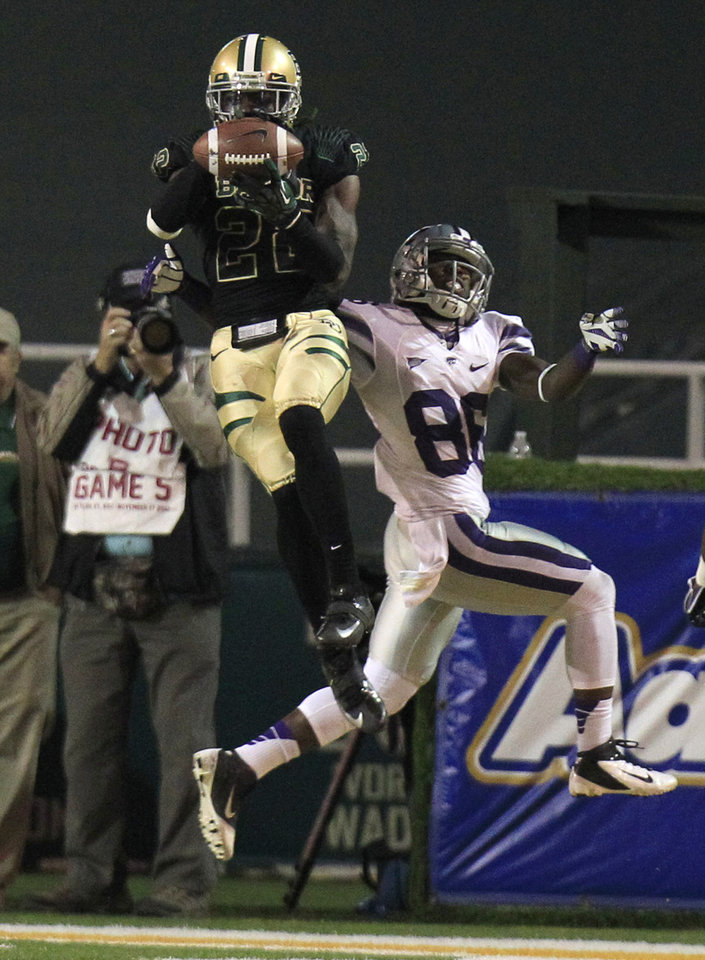 Baylor cornerback Joe Williams (22) intercepts a pass against Kansas State Wildcats wide receiver Tramaine Thompson (86) during the second half of the NCAA college football game Saturday, Nov. 17, 2012, in Waco Texas. Baylor won 52-24. (AP Photo/LM Otero)