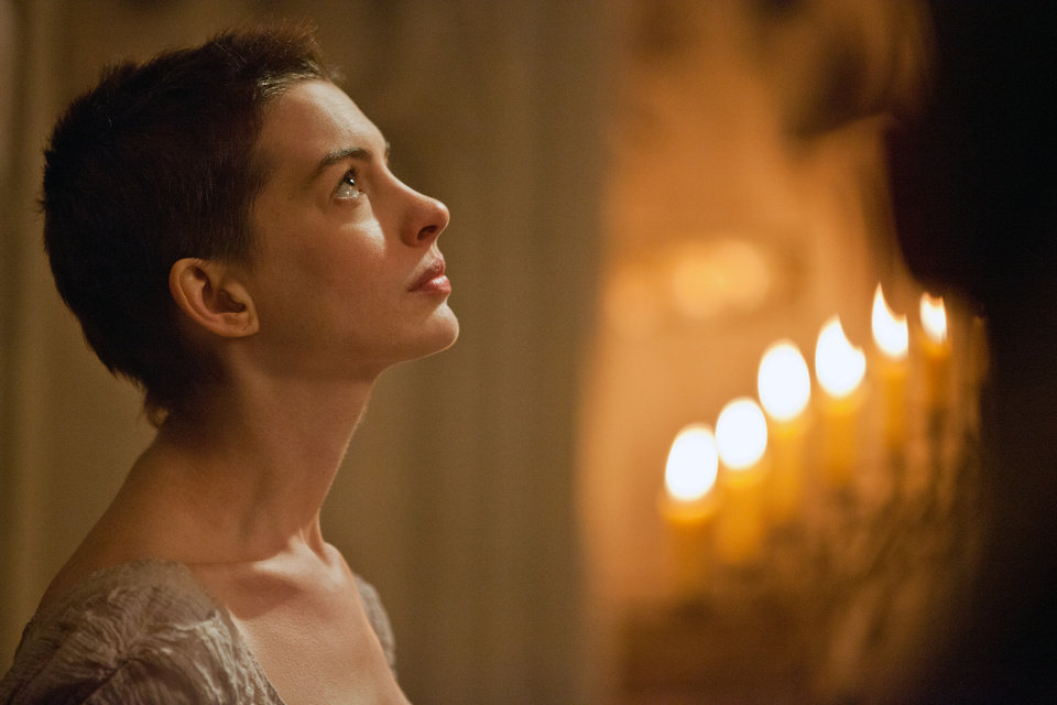 "This film image released by Universal Pictures shows actress Anne Hathaway portraying Fantine, a struggling, sickly mother forced into prostitution in 1800s Paris, in a scene from the screen adaptation of ""Les Miserables.""  Hathaway was nominated Thursday, Dec. 13, 2012 for a Golden Globe for best supporting actress for her role in ""Les Miserables.""  The 70th annual Golden Globe Awards will be held on Jan. 13. (AP Photo/Universal Pictures, Laurie Sparham) ORG XMIT: NYET714"