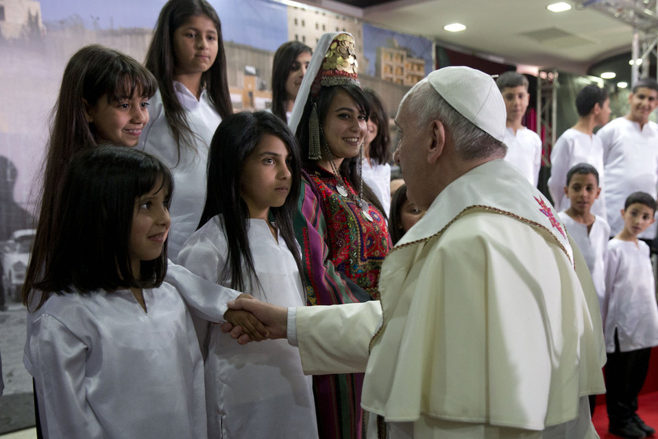 Photo - Pope Francis meets children in the Phoenix Center of the Dheisheh refugee camp, near the West Bank town of Bethlehem, Sunday, May 25, 2014. Pope Francis plunged Sunday into Mideast politics during his Holy Land pilgrimage, calling the current stalemate in peace efforts