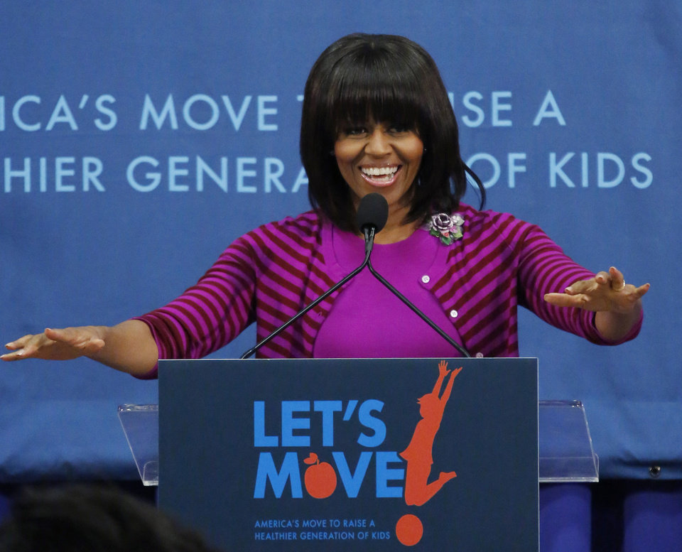 "First lady Michelle Obama motions before speaking at a ""Let's Move!"" program for 400 children at the Eastside and Northside Elementary Schools in Clinton, Miss., Wednesday, Feb. 27, 2013. Obama and television chef Rachel Ray visited with the children and conducted a cooking contest between the schools chefs. (AP Photo/Rogelio V. Solis)"