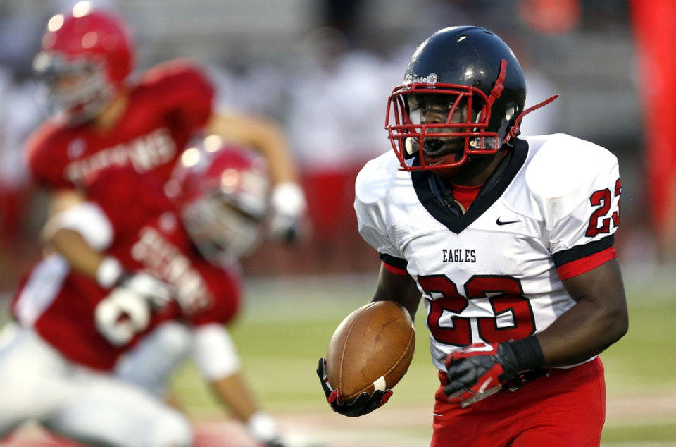 Photo - Del City's Anthony Mason runs up field during a high school scrimmage between Carl Albert High School and Del City at Carl Albert High School Friday, Aug. 17, 2012. Photo by Sarah Phipps, The Oklahoman