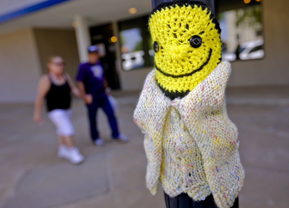 Photo - Knitted art is displayed in the Enid town square as part of the Yarnover Enid community art event.  Photo by Chris Landsberger, The Oklahoman  CHRIS LANDSBERGER - CHRIS LANDSBERGER