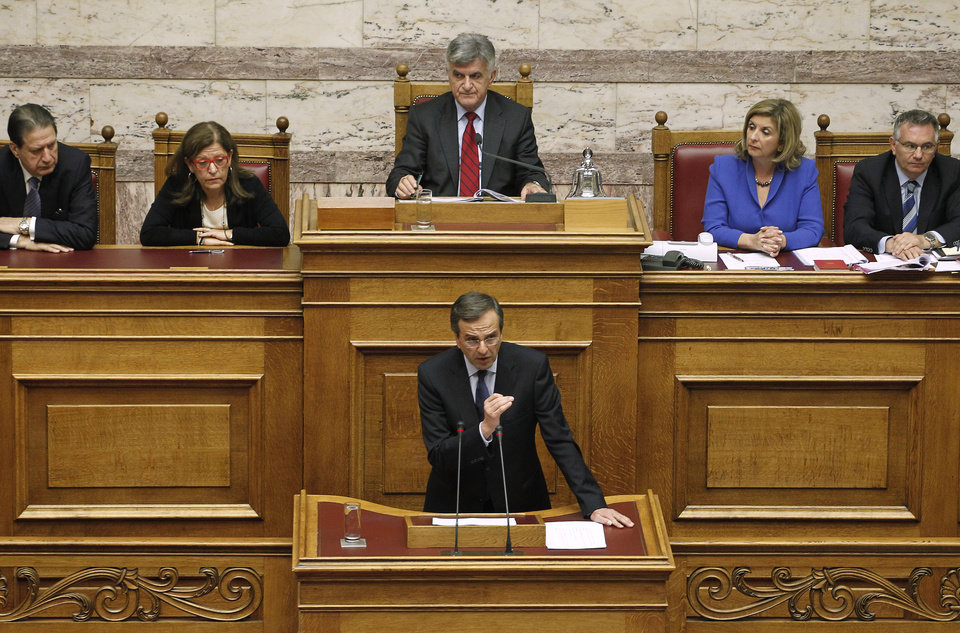 Photo - Conservative opposition leader Antonis Samaras, bottom center, speaks during a parliament session in Athens, Thursday, Nov. 3, 2011. Samaras called on the prime minister to resign and led his party in a dramatic walkout during a parliamentary debate about the viability of the government. (AP Photo/Petros Giannakouris) ORG XMIT: XPG112