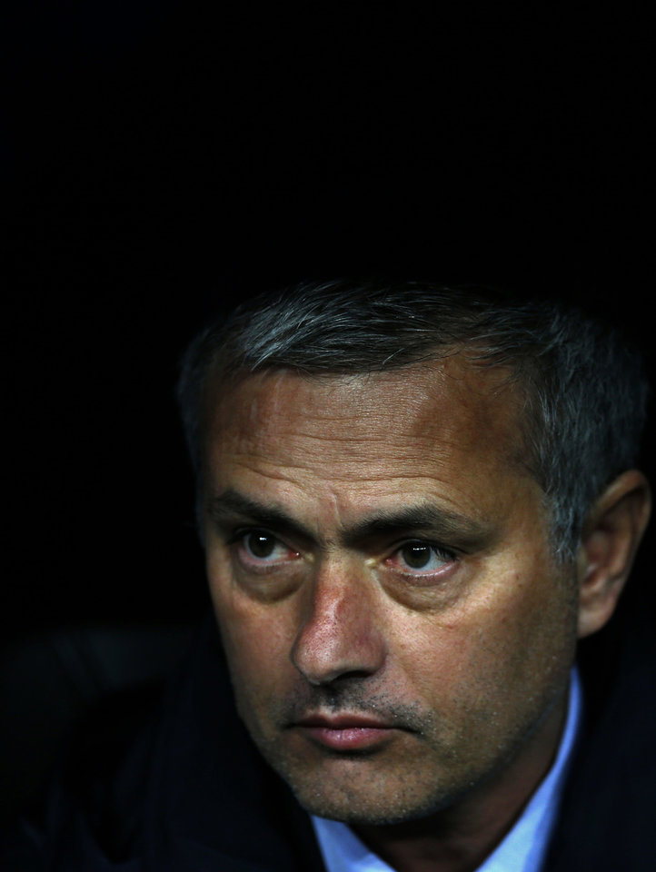 Real Madrid's coach Jose Mourinho from Portugal looks out from the players bench before the start of the Copa del Rey final soccer match between Atletico de Madrid and Real Madrid at the Santiago Bernabeu stadium in Madrid, Spain, Friday, May 17, 2013. (AP Photo/Daniel Ochoa de Olza)