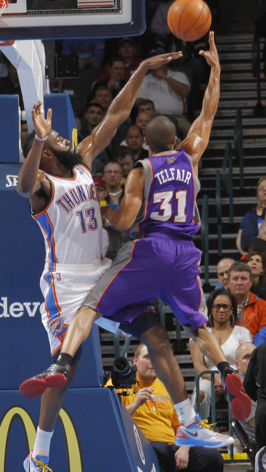 Photo - Oklahoma City Thunder guard James Harden (13) blocks the shot of Phoenix Suns point guard Sebastian Telfair (31) during the NBA basketball game between the Oklahoma City Thunder and the Phoenix Suns at the Chesapeake Energy Arena on Wednesday, March 7, 2012 in Oklahoma City, Okla.  Photo by Chris Landsberger, The Oklahoman