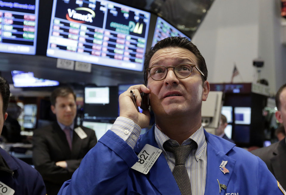 Trader Leon Montana, right, works on the floor of the New York Stock Exchange Thursday, Feb. 28, 2013. The stock market pushed higher Thursday afternoon, sending the Dow tantalizingly close to a record high. (AP Photo/Richard Drew)