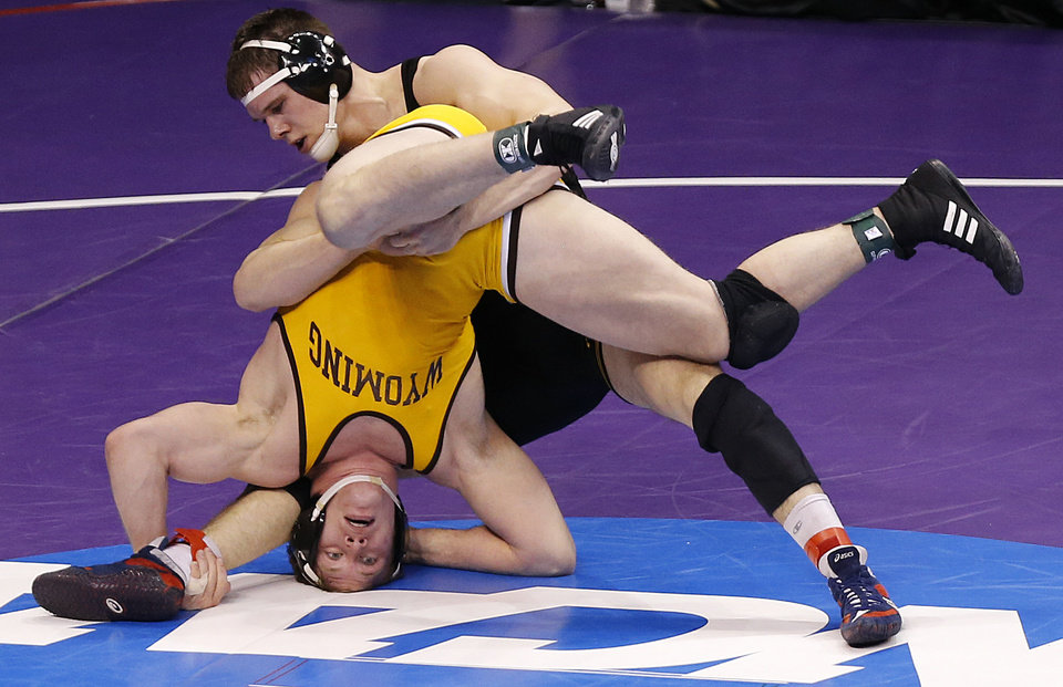 Photo - Wyoming's Shane Woods takes on Iowa's Nathan Burak in the 197 pound match during the 2014 NCAA Div. 1 Wrestling Championships at Chesapeake Energy Arena in Oklahoma City, Okla. on Thursday, March 20, 2014. Photo by Chris Landsberger, The Oklahoman