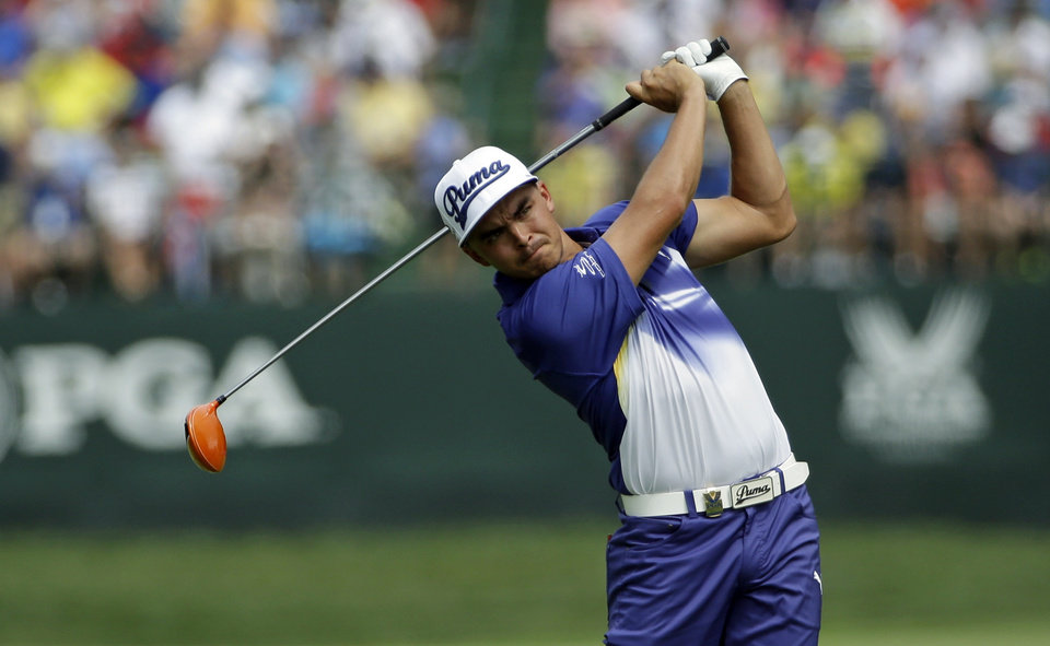 Photo - Rickie Fowler watches his tee shot on the fifth hole during the third round of the PGA Championship golf tournament at Valhalla Golf Club on Saturday, Aug. 9, 2014, in Louisville, Ky. (AP Photo/David J. Phillip)