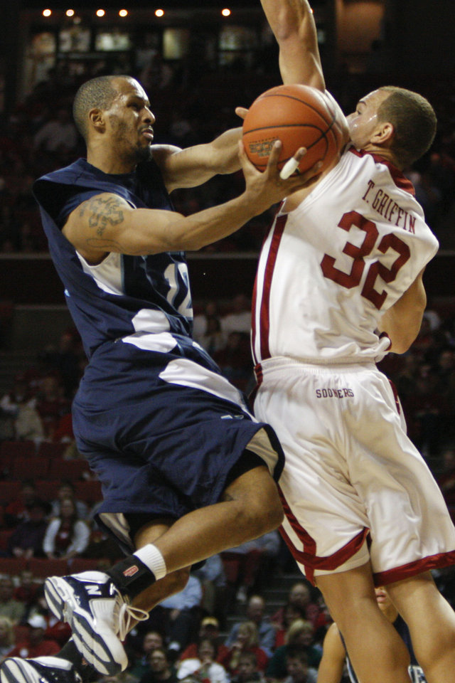 Photo - UNIVERSITY OF OKLAHOMA, OU:  Maine guard Junior Bernal, left, goes up for a basket as Oklahoma's Taylor Griffin, right, defends in the first half of an NCAA college basketball game on Wednesday, Dec. 10, 2008, in Norman, Okla.  (AP Photo/Alonzo Adams) ORG XMIT: OKAA101