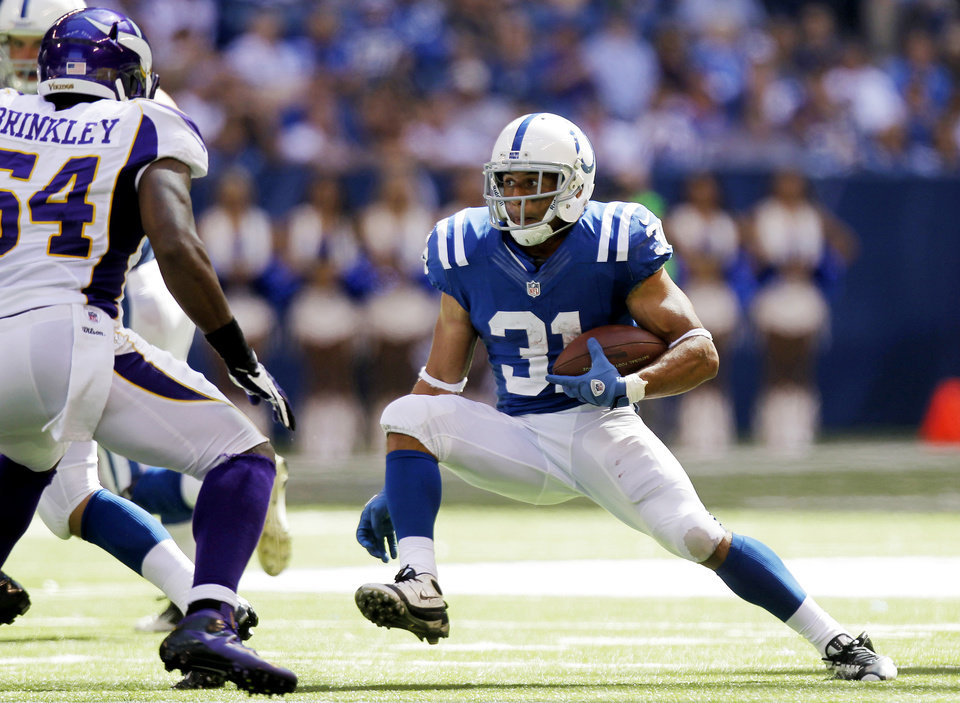 Photo -   Indianapolis Colts' Donald Brown (31) runs against Minnesota Vikings' Jasper Brinkley (54) during the second half of an NFL football game in Indianapolis, Sunday, Sept. 16, 2012. (AP Photo/Michael Conroy)
