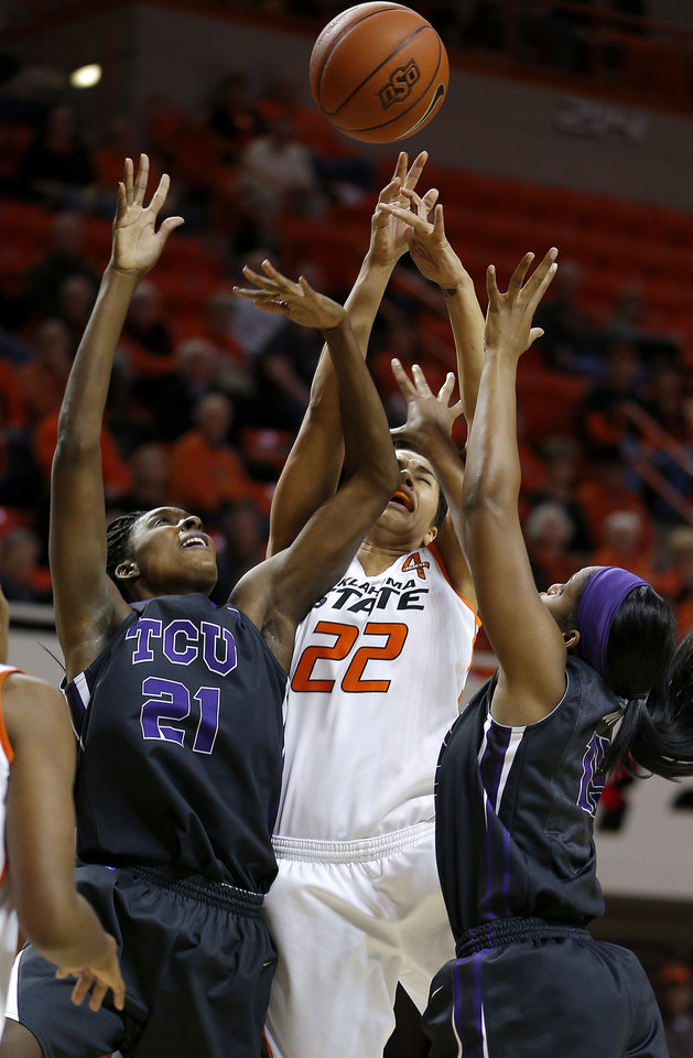 Oklahoma State's Brittney Martin (22) goes for a rebound between TCU's Latricia Lovings (21)and Jada Butts (15) during a women's NCAA college basketball game between Oklahoma State University (OSU) and TCU at Gallagher-Iba Arena in Stillwater, Okla., Tuesday, Jan. 14, 2014.  Photo by Bryan Terry, The Oklahoman