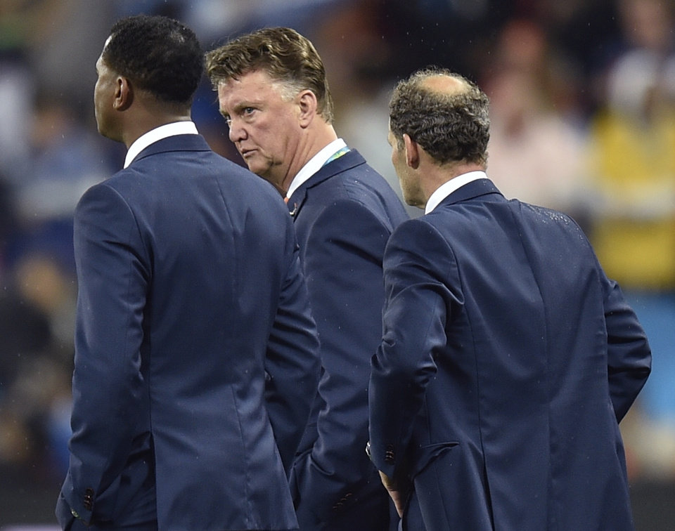 Photo - Netherlands' head coach Louis van Gaal reacts after a shootout at the end of the World Cup semifinal soccer match between the Netherlands and Argentina at the Itaquerao Stadium in Sao Paulo Brazil, Wednesday, July 9, 2014. Argentina won 4-2 on penalties after the match ended 0-0 after extra time.  (AP Photo/Martin Meissner)