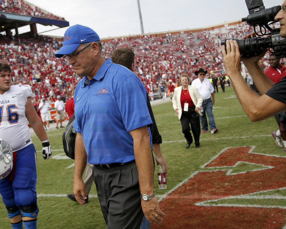Photo - Tulsa coach Bill Blankenship walks off the field after a college football game between the University of Oklahoma Sooners (OU) and the Tulsa Golden Hurricane at Gaylord Family-Oklahoma Memorial Stadium in Norman, Okla., on Saturday, Sept. 14, 2013. Oklahoma won 51-20. Photo by Bryan Terry, The Oklahoman