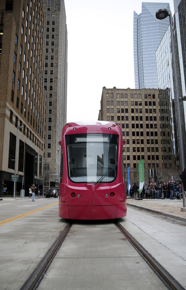 Photo - A streetcar sits on its tracks during grand open ceremonies for the Oklahoma City Streetcar system at Leadership Square,  Friday, Dec. 14, 2018. Photo by Sarah Phipps, The Oklahoman
