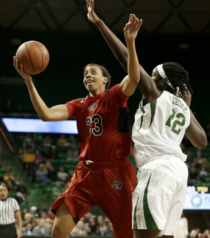 Photo - Texas Tech forward/center Shauntal Nobles (33) fights Baylor's Sune Agbuke (22) for a shot opportunity in the first half of an NCAA college basketball game, Wednesday, Jan. 29, 2014, in Waco, Texas. (AP Photo/Tony Gutierrez)