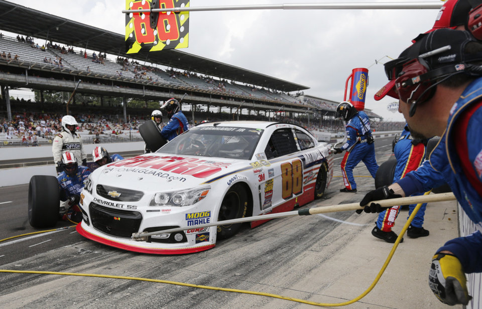 Photo - Dale Earnhardt Jr. pits during the Brickyard 400 auto race at Indianapolis Motor Speedway in Indianapolis, Sunday, July 27, 2014. (AP Photo/Robert Baker)