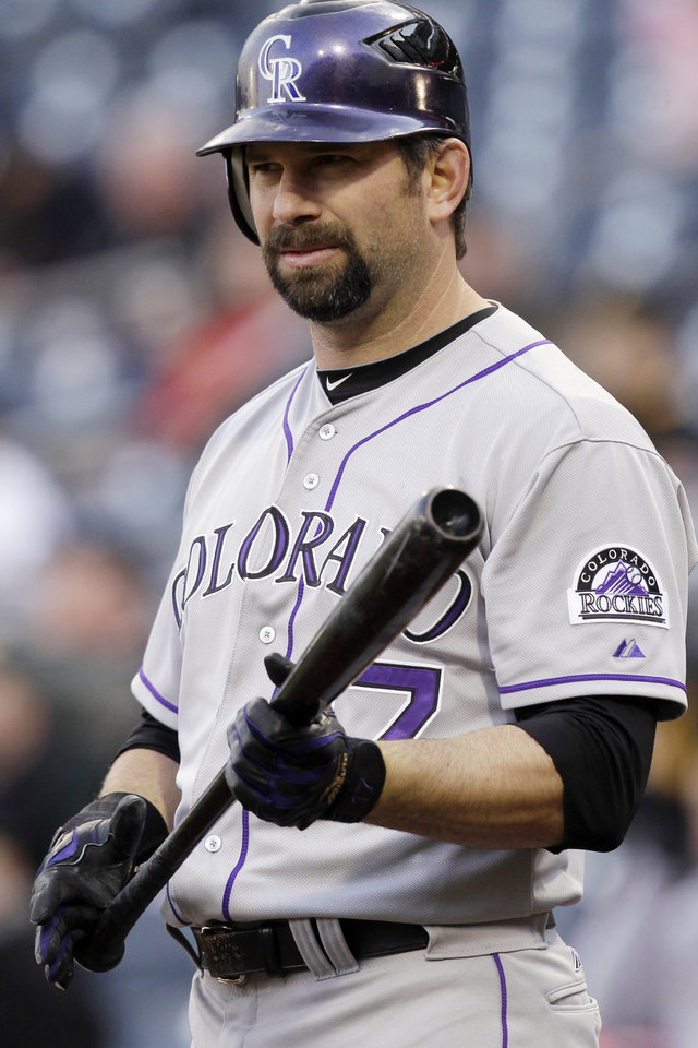 FILE- In this April 24, 2012, file photo, Colorado Rockies' Todd Helton warms up on deck during the first inning of a baseball game against the Pittsburgh Pirates in Pittsburgh. Helton has been arrested on a charge of driving under the influence, the team announced Wednesday, Feb. 6, 2013. The team says Helton was arrested Wednesday morning in the Denver suburb of Thornton. No other details have been released. (AP Photo/Gene J. Puskar, File)