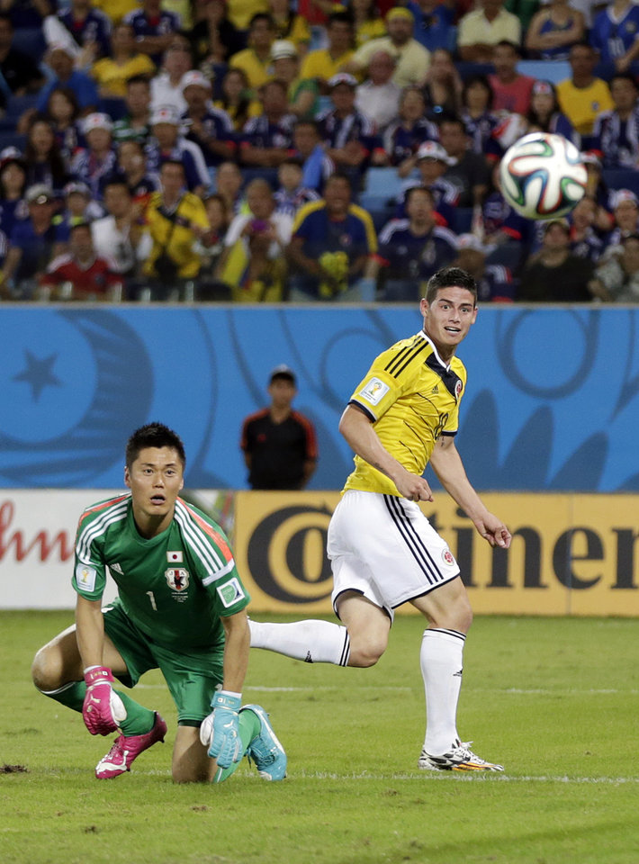 Photo - FILE - In this June 24, 2014 file photo, Japan's goalkeeper Eiji Kawashima eyes the ball while it goes to the net as Colombia's James Rodriguez scores during the group C World Cup soccer match at the Arena Pantanal in Cuiaba, Brazil. The Colombia playmaker finished off a sublime individual display by twisting and turning through a tired Japanese defense and chipping in an astonishing goal with a minute left. (AP Photo/Dolores Ochoa, File)
