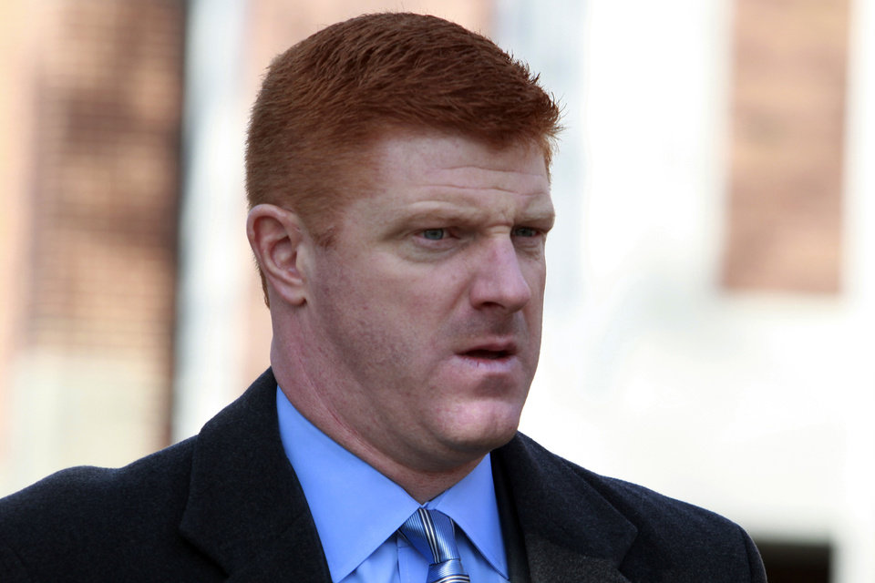 FILE - In this Jan. 25, 2012 file photo, former Penn State assistant football coach Mike McQueary arrives to the Pasquerilla Spiritual Center on the Penn State campus for the funeral service of former Penn State football coach Joe Paterno in State College, Pa. Former FBI director Louis Freeh, who led a Penn State-funded investigation into the university's handling of molestation allegations against former assistant football coach Jerry Sandusky, is scheduled to release his highly anticipated report Thursday, July 12, 2012. (AP Photo/Jacqueline Larma, File)