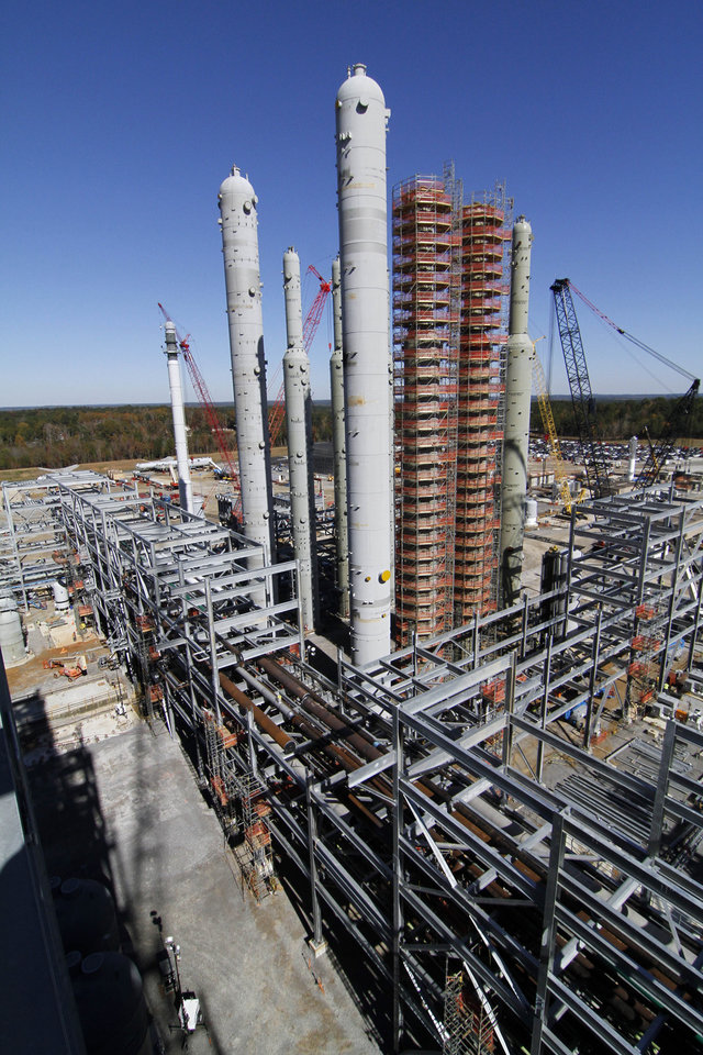 In this Nov. 13, 2012 photograph, the H2S and CO2 absorber vessels are undergoing construction at Mississippi Power's Kemper County energy facility near DeKalb, Miss. Mississippi Power's Kemper County plant, still under construction, is designed to use a soft form of coal called lignite in a gasification process to generate power. (AP Photo/Rogelio V. Solis)
