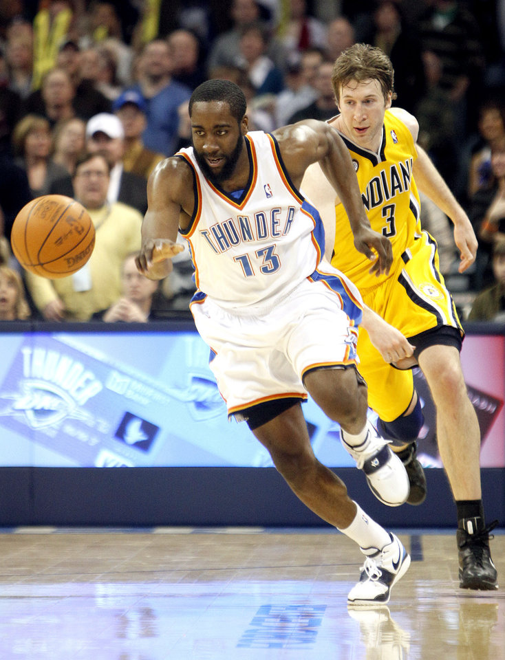 Photo - Oklahoma City's James Harden (13) steals the ball from Indiana's Troy Murphy (3) during the basketball game between the Oklahoma City Thunder and the Indiana Pacers, Saturday, Jan. 9, 2010 at the Ford Center in Oklahoma CIty. Photo by Sarah Phipps, The Oklahoman