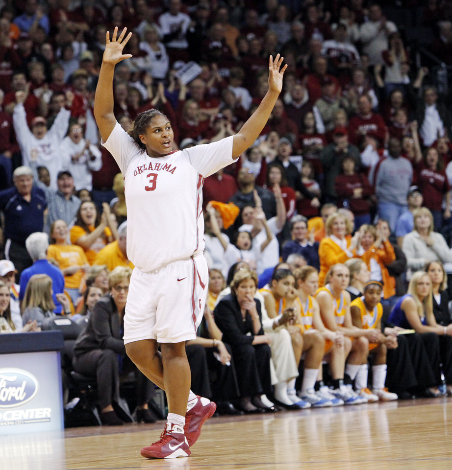 Photo - OU's Courtney Paris (3) waves to fans after fouling out of the game with 38.2 seconds left in the second half of the women's college basketball game between the University of Oklahoma and Tennessee at the Ford Center in Oklahoma City, Monday, February 2, 2009. OU won, 80-70. Paris finished with 9 points and 12 rebounds, breaking her streak of consecutive double-doubles. BY NATE BILLINGS, THE OKLAHOMAN ORG XMIT: KOD