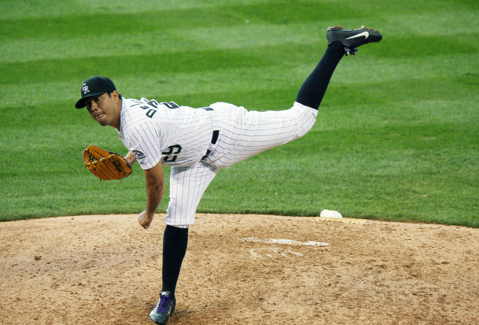 Photo - Colorado Rockies starting pitcher Jorge De La Rosa works against the Washington Nationals in the eighth inning of the Rockies' 6-4 victory in a baseball game in Denver on Wednesday, July 23, 2014. (AP Photo)