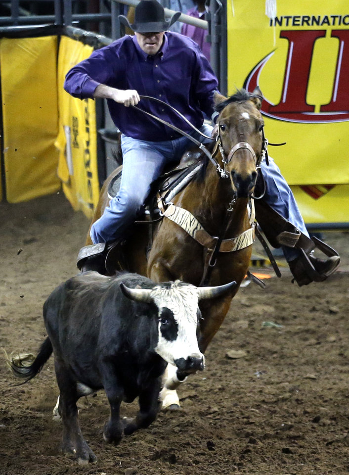 Photo - Jason Stewart of Bristow was able to ride Stevie in the steer wrestling competition at the International Finals Rodeo on Friday. Photo by Sarah Phipps, The Oklahoman