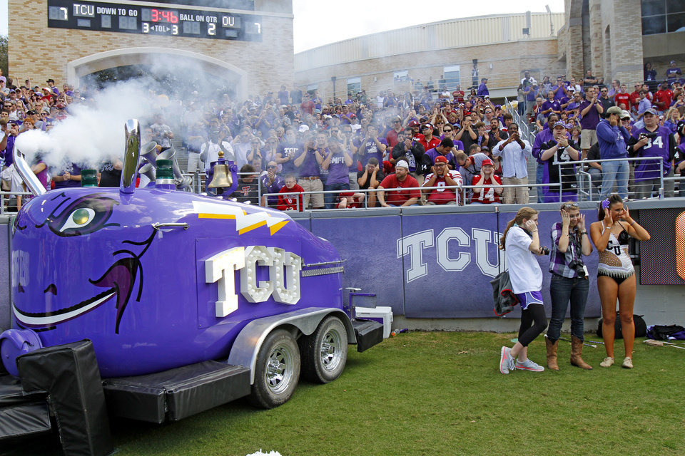 Photo - The TCU Frog Horn blows after a TCU score during a college football game between the University of Oklahoma Sooners (OU) and the Texas Christian University Horned Frogs (TCU) at Amon G. Carter Stadium in Fort Worth, Texas, Saturday, Dec. 1, 2012. Oklahoma won 24-17. Photo by Bryan Terry, The Oklahoman