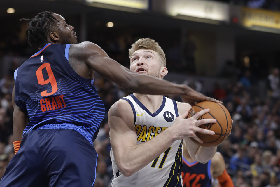 Photo - Indiana Pacers' Domantas Sabonis (11) puts up a shot against Oklahoma City Thunder's Jerami Grant (9) during the second half of an NBA basketball game, Thursday, March 14, 2019, in Indianapolis. Indiana won 108-106. (AP Photo/Darron Cummings)