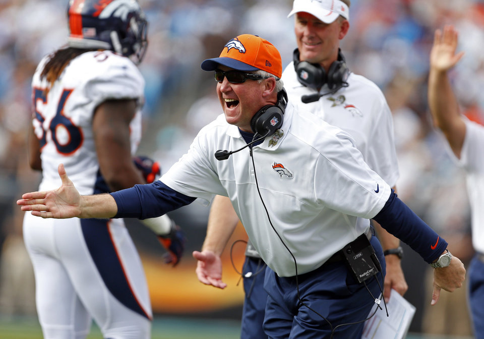 Photo -   Denver Broncos head coach John Fox reacts after Trindon Holliday's punt return for a touchdown against the Carolina Panthers during the first half of an NFL football game in Charlotte, N.C., Sunday, Nov. 11, 2012. (AP Photo/Bob Leverone)