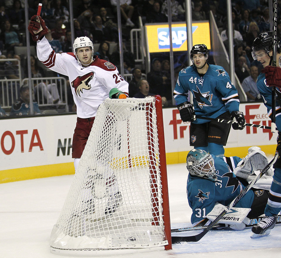 Phoenix Coyotes defenseman Oliver Ekman-Larsson (23) reacts after scoring a goal against San Jose Sharks goalie Antti Niemi (31) during the second period an NHL hockey game in San Jose, Calif., Saturday, Oct. 5, 2013. (AP Photo/Tony Avelar)