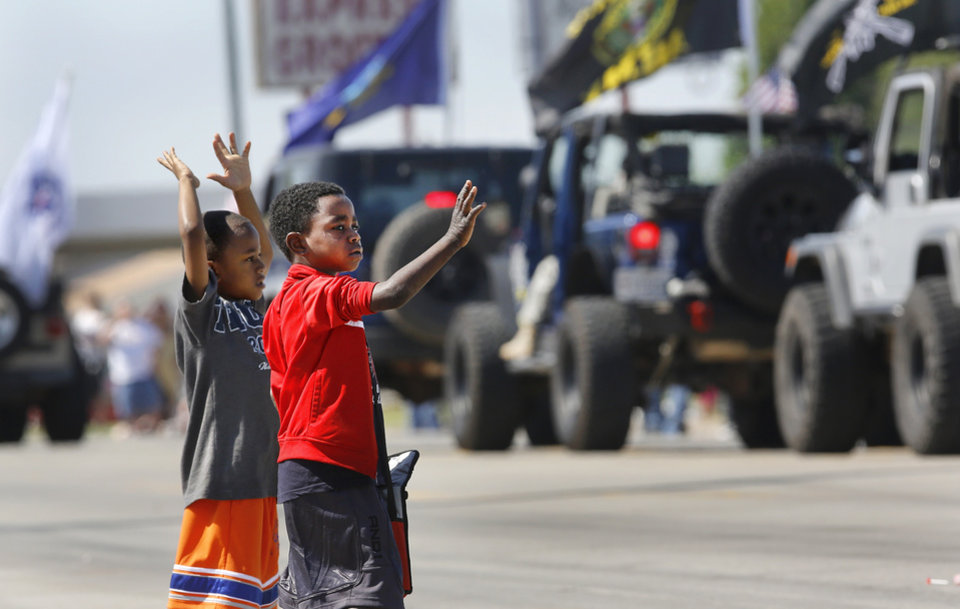 Boys wave at units as they pass during the Armed Forces Day parade in Del City, Saturday morning, May 11, 2013. Photo by Jim Beckel, The Oklahoman.