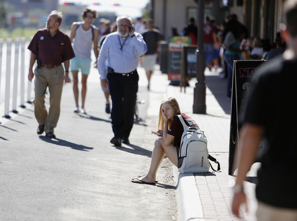 Student Amy Hoeks waits for the Texas A&M campus to reopen while authorities investigate a bomb threat Friday, Oct. 19, 2012 in College Station, Texas. A&M says bus service on the sprawling campus has been rerouted and at least two nearby churches are offering to serve as shelters until the evacuation order is rescinded.(AP Photo/Jon Eilts)