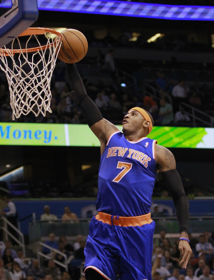 New York Knicks' Carmelo Anthony makes an uncontested shot off of a fast break against the Orlando Magic during the first half of an NBA basketball game, Tuesday, Nov. 13, 2012, in Orlando, Fla. (AP Photo/John Raoux)