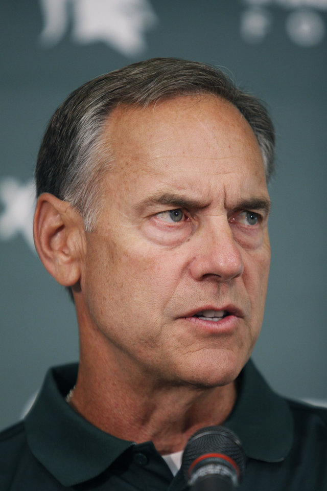 Photo - Michigan State coach Mark Dantonio addresses reporters during the team's NCAA college football media day, Monday, Aug. 4, 2014, in East Lansing, Mich. (AP Photo/Al Goldis)
