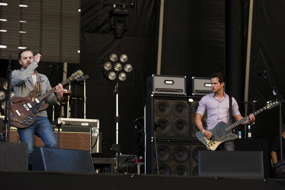 Photo - Caleb Followill, left, and Jared Followill from the band Kings of Leon. AP PHOTO  Charles Sykes