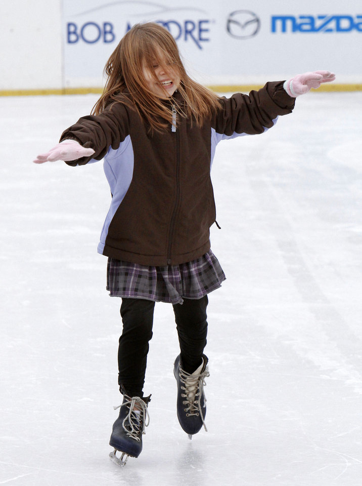 Hannah Downey, 9, catches her balance at the Edmond Outdoor Ice Skating Rink.   PHOTO BY PAUL HELLSTERN, THE OKLAHOMAN
